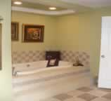 Ceramic tile around tub and tray ceiling