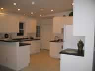 white cabinets, recessed ceiling lights